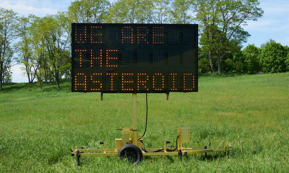 7221 we are the asteroid - road warning sign